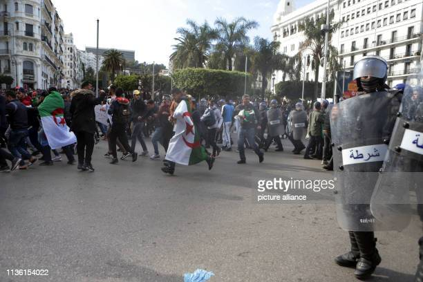 Security forces attempt to disperse Algerian protesters during an antigovernment demonstration Algerians continued to demonstrate although newly...