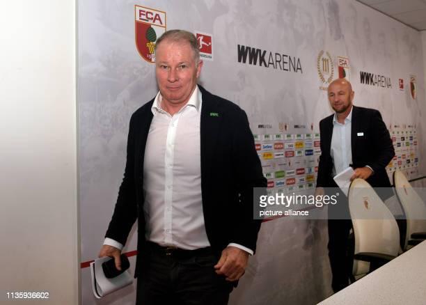 April 2019, Bavaria, Augsburg: Sports Director Stefan Reuter and President Klaus Hofmann leave a press conference of FC Augsburg. The Bundesliga team...
