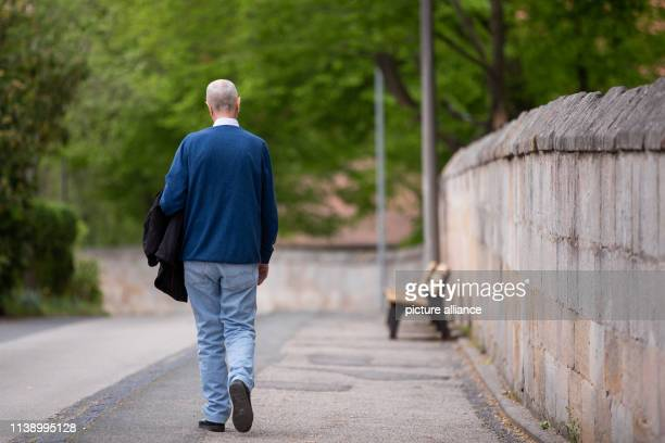 Wolfgang H resident of an old people's home walks in front of the facility The 72yearold is addicted to alcohol and is currently living in the closed...