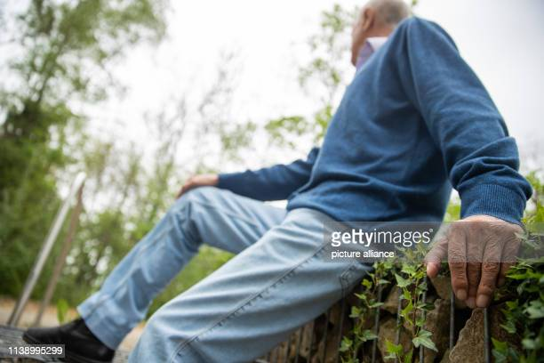 Wolfgang H resident of an old people's home sits in front of the facility The 72yearold is addicted to alcohol and is currently living in the closed...