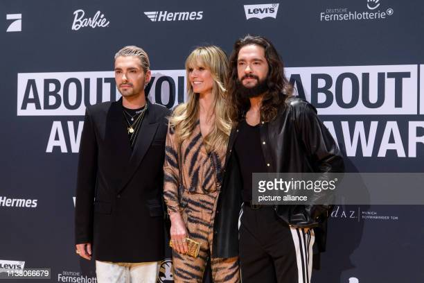 Heidi Klum model businesswoman and presenter of Germany's Next Topmodel her fiancé Tom Kaulitz singer of the band Tokio Hotel and his twin brother...