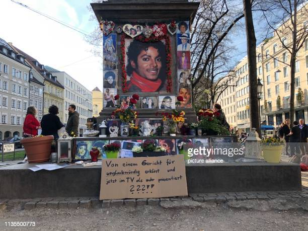 A sign with the inscription Declared untrustworthy by a court and now presented on TV as true stands in front of the monument to OrlandodiLasso a...