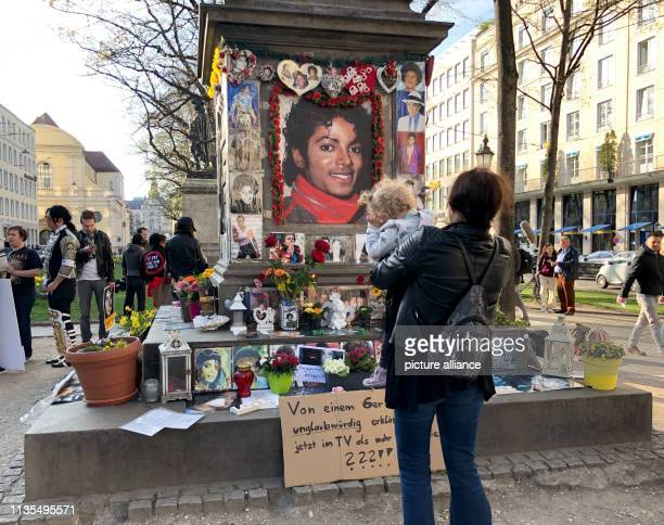 A woman stands in front of the monument to OrlandodiLasso a composer and conductor of the Renaissance who was converted into a Michael Jackson...