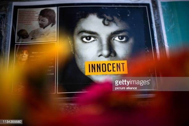 Innocent is written on a photo of Michael Jackson hanging on the monument to Jackson in front of the Bavarian Court Photo Sina Schuldt/dpa