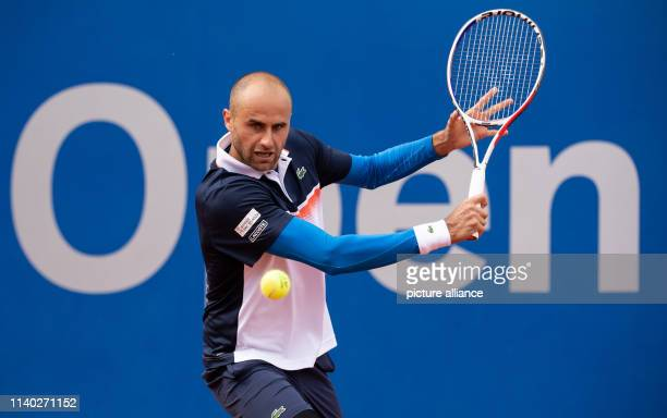 April 2019, Bavaria, Munich: Tennis: ATP-Tour - Munich, singles, men, 1st round: Molleker - Copil . Marius Copil beats a backhand. Photo: Sven...