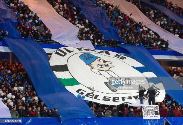 April 2019, Bavaria, Nürnberg: Soccer: Bundesliga, 1st FC Nuremberg - FC Schalke 04, 29th matchday in Max Morlock Stadium. Nuremberg fans show a...