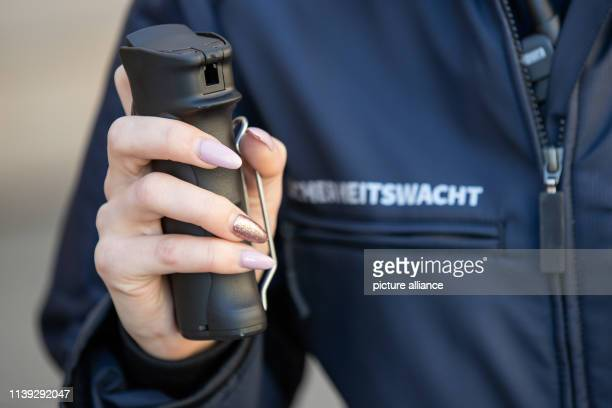 A member of the Bavarian security guard presents a pepper spray with his new clothes The volunteers receive neon yellow warning vests flashlights and...