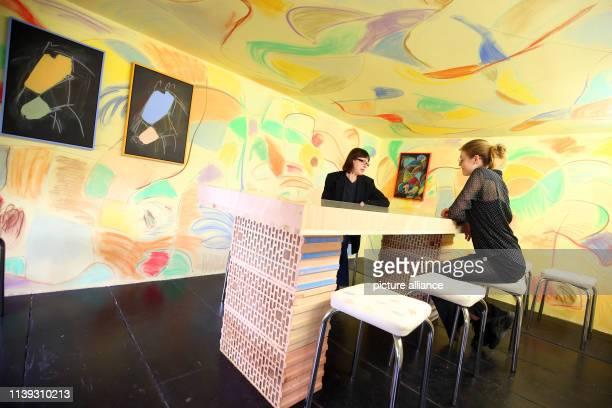 Employees of the Galerie ChertLüdde in Ritterstraße in Kreuzberg are sitting at an installation by the artist Sol Calero entitled Archivos olvidados...