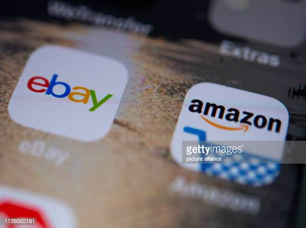 April 2019, Berlin: ILLUSTRATION - The logos of the apps of the online shop Amazon and the online marketplace ebay can be seen on the display of a...