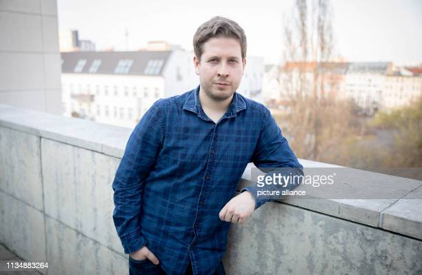 Kevin Kühnert Federal Chairman of the Jusos looks into the photographer's camera on the terrace of the Willy Brandt House after an interview with the...