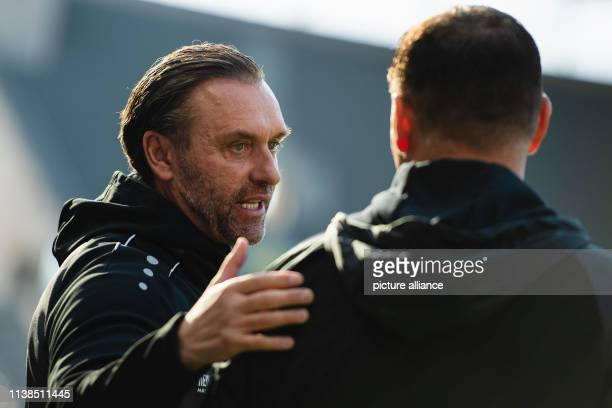 Soccer Bundesliga Hertha BSC Hannover 96 30th matchday in the Olympic Stadium Coach Thomas Doll of Hannover 96 welcomes coach Pal Dardai of Hertha...