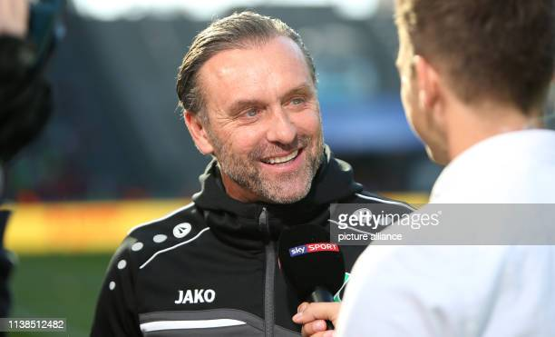Soccer Bundesliga Hertha BSC Hannover 96 30th matchday Hanover coach Thomas Doll speaks in an interview before the start of the game Photo Andreas...