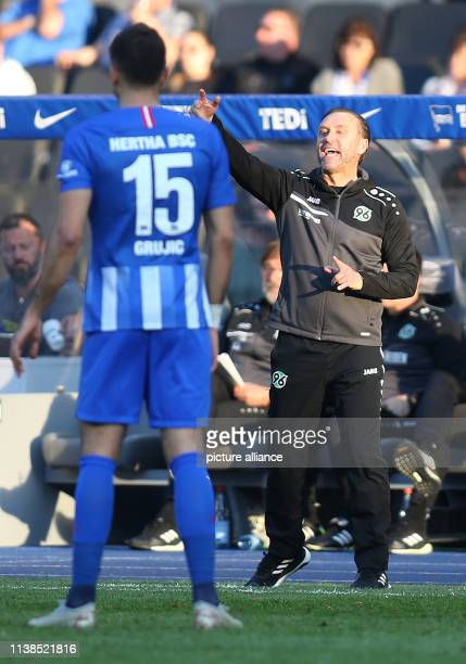 Soccer Bundesliga Hertha BSC Hannover 96 30th matchday Hanover coach Thomas Doll stands gesticulating on the edge of the field Photo Andreas Gora/dpa...