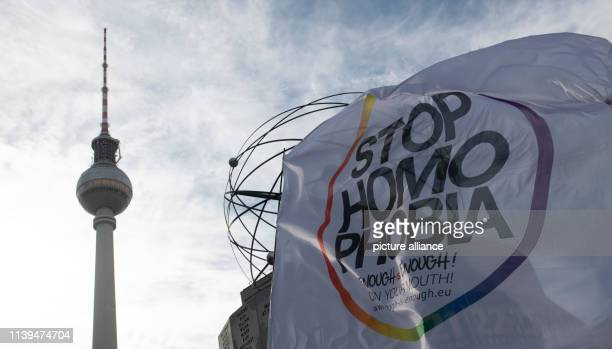 stop homophobia is on a flag at Alexanderplatz Numerous lesbian couples drew attention to the International Day for Lesbian Visibility with a Kiss in...