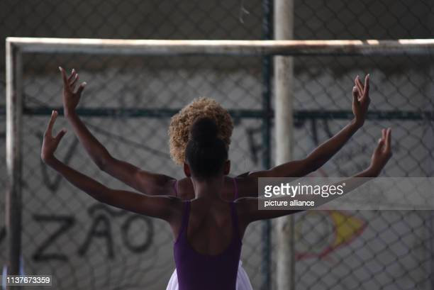 A girl follows Tuanys Nascimentos movements during a ballet class in the favela Morro do Adeus The lessons are part of the project Na Ponta dos Pes...