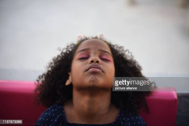 A girl has her makeup done before ballet lessons at the favela Morro do Adeus The lessons are part of the project Na Ponta dos Pes which was...