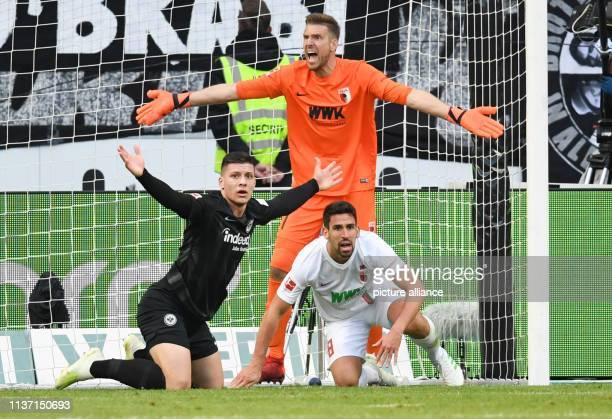 Soccer Bundesliga Eintracht Frankfurt FC Augsburg 29th matchday in the CommerzbankArena Frankfurt's Luka Jovic reacts alongside Augsburg's Rani...
