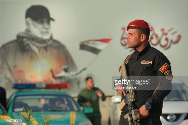 April 2019, Iraq, Baghdad: An armed member of the Iraqi Special Operations Forces secures the premises where a conference is being held by the...