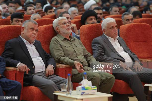 April 2019, Iraq, Baghdad: Hadi Al-Amiri , former Iraqi minister of transportation and Leader of the Fatah Alliance, Abu Mahdi al-Muhandis,...