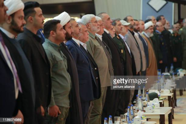 April 2019, Iraq, Baghdad: Hadi Al-Amiri , former Iraqi minister of transportation and Leader of the Fatah Alliance, Abu Mahdi al-Muhandis ,...
