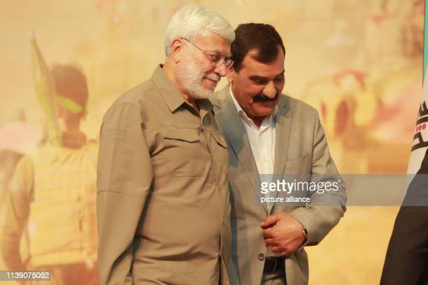 April 2019, Iraq, Baghdad: Iraqi-Iranian military commander of the Popular Mobilization Forces Abu Mahdi al-Muhandis arrives to attend a conference...