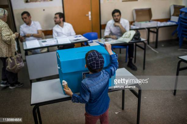 An UltraOrthodox Jewish child casts a parent's vote at a polling station during the Israeli parliamentary elections Photo Ilia Yefimovich/dpa