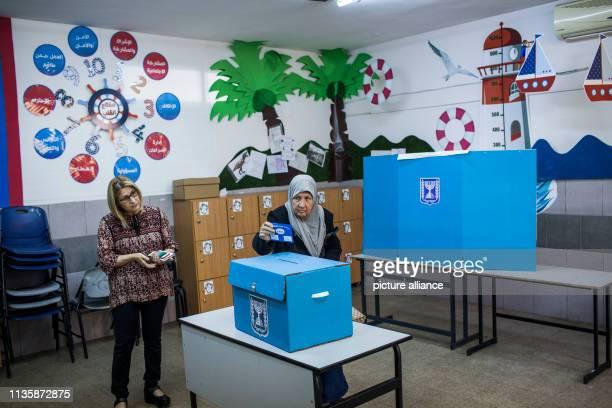An Israeli Arab woman casts her vote in the Israeli parliamentary elections Photo Ilia Yefimovich/dpa