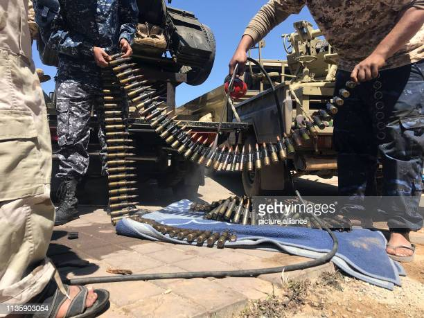 April 2019, Libya, Tripoli: Fighters of a Misurata-based armed group, loyal to the UN-backed Government of National Accord of Fayez Serraj, prepare...