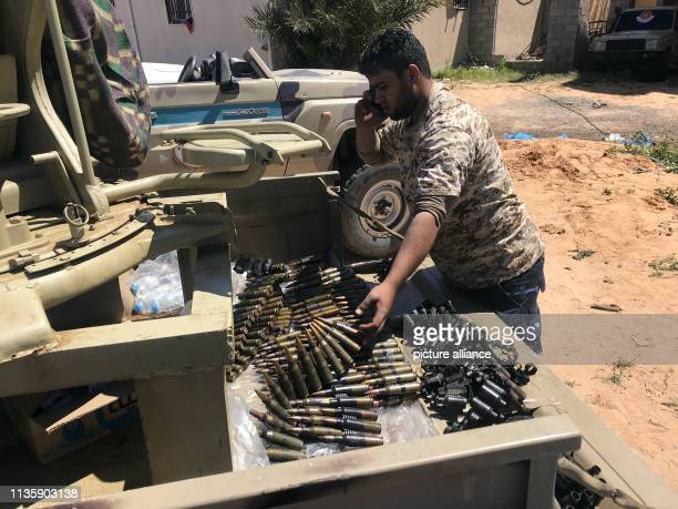 Fighters of a Misuratabased armed group loyal to the UNbacked Government of National Accord of Fayez Serraj prepare their ammunition before heading...