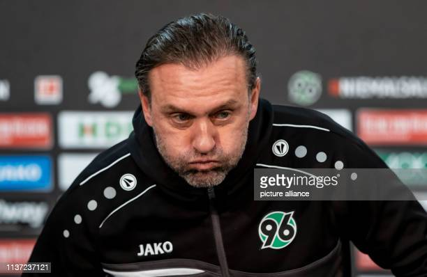 Soccer Bundesliga Hannover 96th Hanover coach Thomas Doll during a Pk in the HDIArena Photo Peter Steffen/dpa IMPORTANT NOTE In accordance with the...
