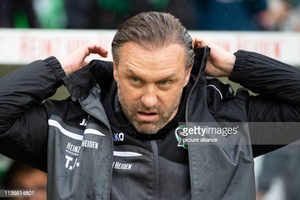 Soccer Bundesliga Hannover 96 FSV Mainz 05 31st matchday in the HDI Arena Hanover coach Thomas Doll puts on his jacket Photo Swen Pförtner/dpa...