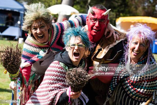 30 April 2019 Lower Saxony St Andreasberg Marion Vicki and Monika dressed up as witches stand together with Jens dressed up as a devil Walpurgis and...