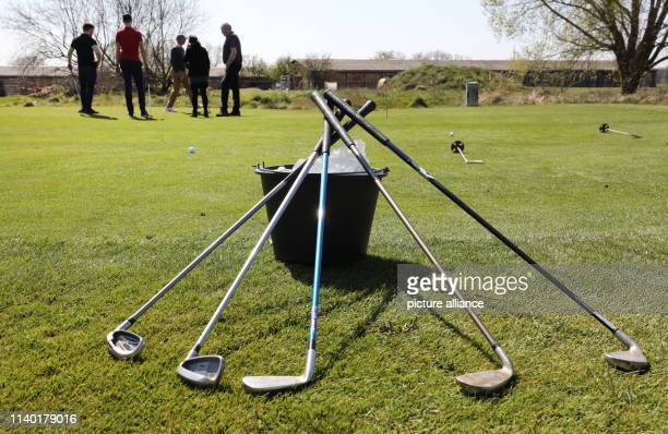 19 April 2019 MecklenburgWestern Pomerania RibnitzDamgarten At a taster course for beginners on the golf course Zum Fischland golf clubs are lying on...