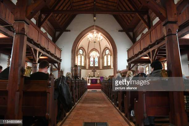 April 2019, Mecklenburg-Western Pomerania, Zinnowitz: Citizens attend a memorial service for 18-year-olds killed in the Evangelical Church of...