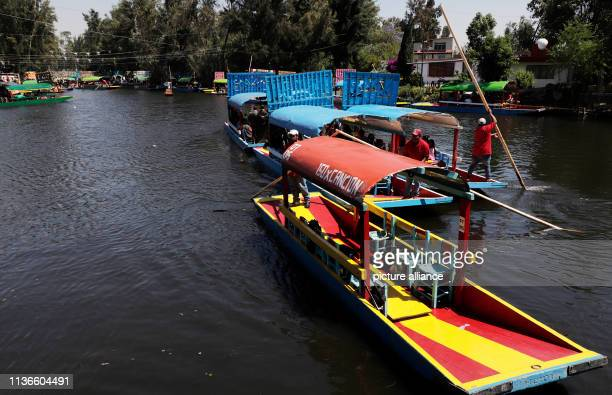 Trajinera operate on a canal in Xochimilco Located on the southern outskirts of the metropolis of millions the canals on which the colourfully...