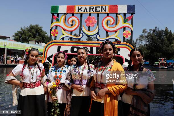 Women from the region are on board a Trajinera in Xochimilco for the competition The most beautiful flower of ejido The traditional event of the...