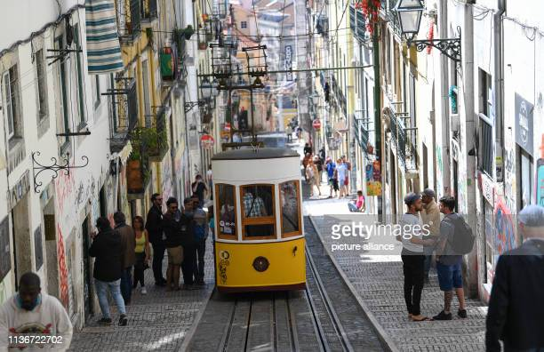 The Elevador da Bica an electric funicular since 1914 runs in the heart of the Bairro Alto district The means of transport overcomes a height...