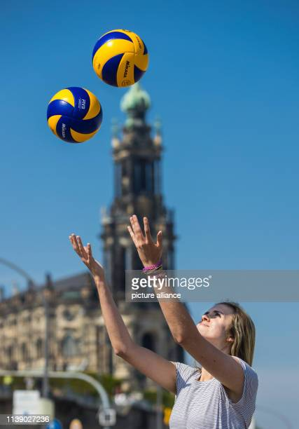 Emma Cyris new outside attacker of the volleyball Bundesliga team Dresdner SC poses with two volley balls on the sidelines of a press conference...