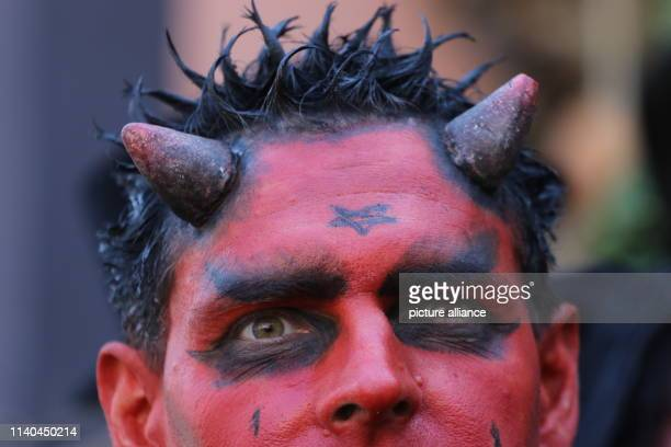 30 April 2019 SaxonyAnhalt Wernigerode A man disguised as a devil walks through the city to Walpurgisfest Tens of thousands celebrated the...