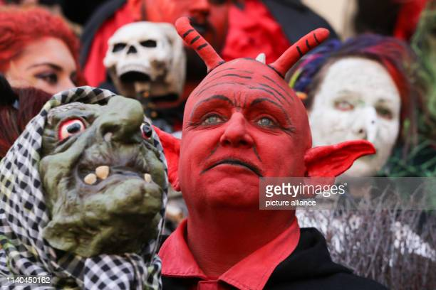 30 April 2019 SaxonyAnhalt Wernigerode People dressed up as witches and devils travel through the city to the Walpurgis Festival where tens of...