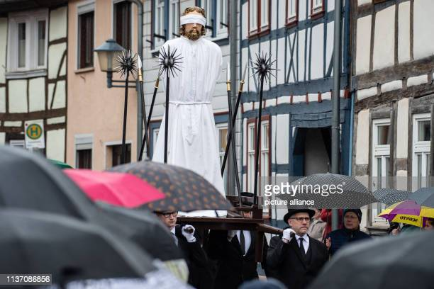 During the Palm Sunday procession in Eichsfeld Catholic believers wear largerthanlife representations symbolizing the suffering and death of Jesus...
