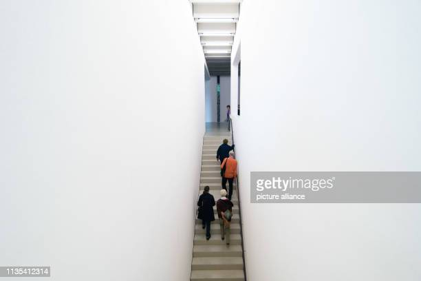 Visitors go up a staircase in the newly opened Bauhaus Museum The new Bauhaus Museum Weimar opened on Friday evening with the permanent exhibition...