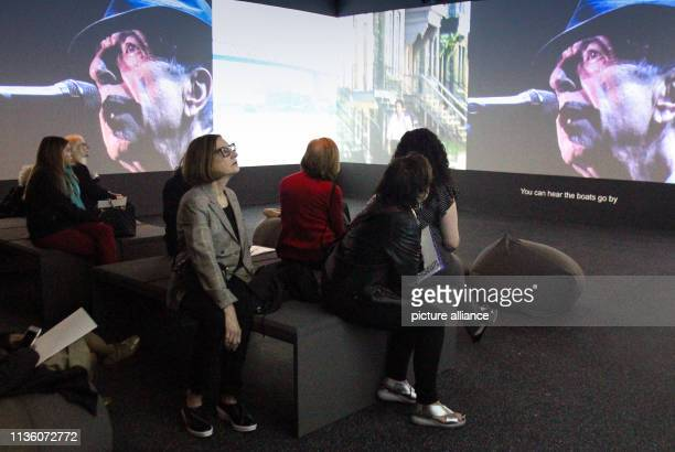 Participants of the Press Preview watch a concert film in the LeonhardCohen exhibition Around three years after the death of Leonard Cohen the Jewish...