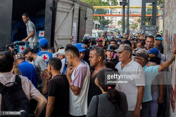 People are waiting to receive aid First relief supplies of the Red Cross have arrived in Venezuela Photo Ruben Sevilla Brand/dpa