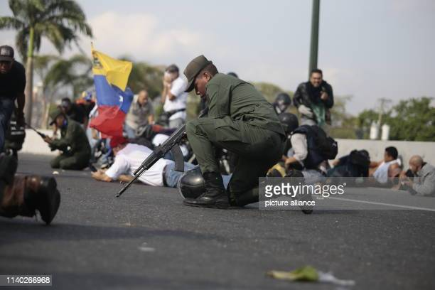 Soldiers and civilians are in the same situation during a mission around the cars in which the selfproclaimed interim president Guaido is driven near...