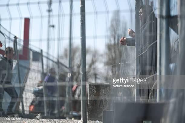 April 2020, Baden-Wuerttemberg, Konstanz: Dozens of people meet at the German-Swiss border between Konstanz and Kreuzlingen. The border barrier has...