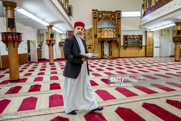 April 2020, Berlin: Imam Mohamed Taha Sabri is standing in the prayer room of the Dar Assalam Mosque in the Neukölln district. Common rituals are...