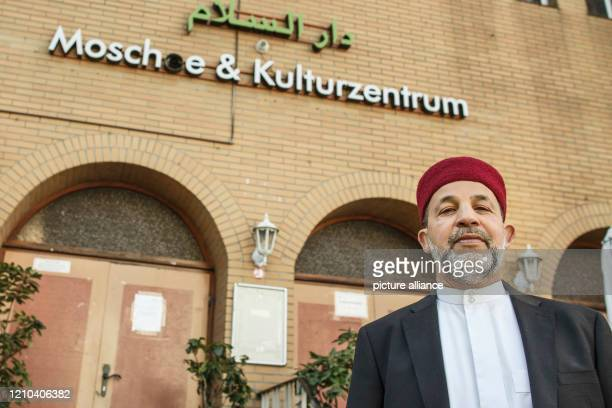 April 2020, Berlin: Imam Mohamed Taha Sabri stands in front of the entrance to the Dar Assalam Mosque in the Neukölln district. Common rituals are...