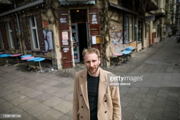 April 2020, Berlin: Sebastian Schrader, landlord of the restaurant Kohlenquelle, stands in front of the restaurant in the district of Prenzlauer...
