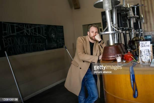 April 2020, Berlin: Sebastian Schrader, landlord of the restaurant Kohlenquelle, stands in the empty restaurant in the district of Prenzlauer Berlin....